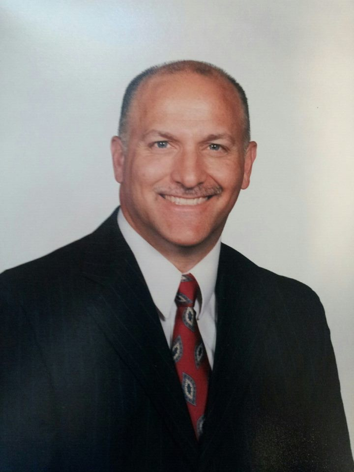 A picture of Brian Staub Himself. White background with a suit on.